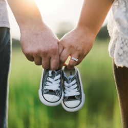 fertility testing | mother, father and baby shoes in field | Tennessee Reproductive Medicine