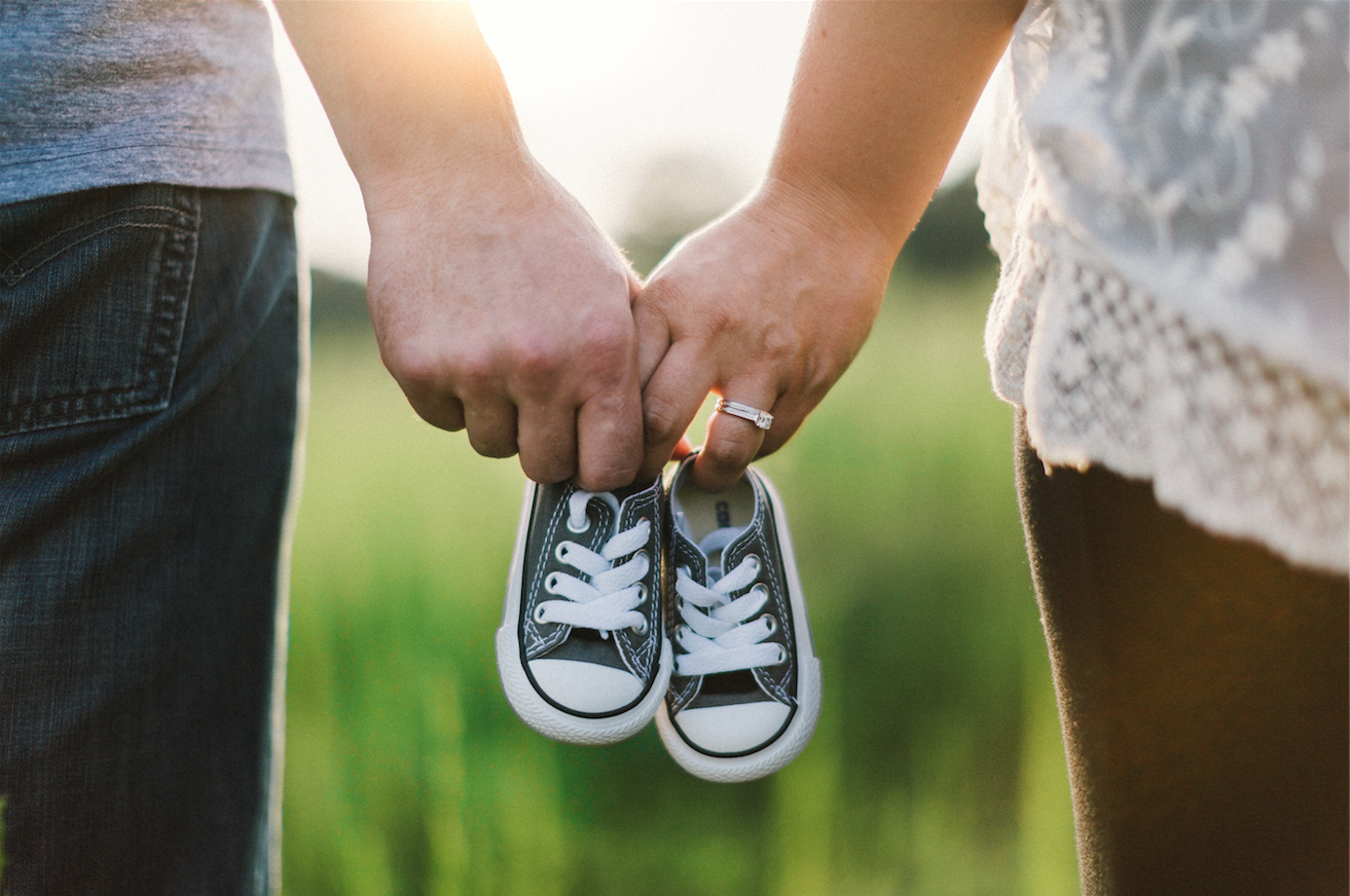 fertility testing | Tennessee Reproductive Medicine | mother, father and baby shoes in field