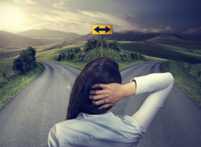 Woman facing a fork in the road making a mini-IVF decision | Tennessee Reproductive Medicine | Chattanooga
