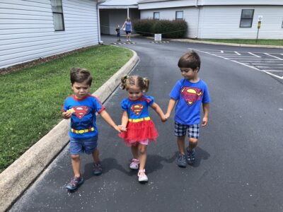 Five year old and three year old twins in superman costumes for our story on vanishing twin syndrome | Tennessee Reproductive Medicine | Chattanooga