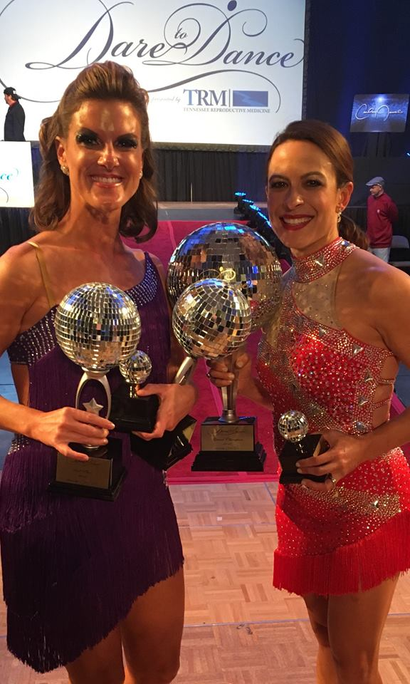 Dr. Scotchie being presented the Dare to Dance competition award   Tennessee Reproductive Medicine   Chattanooga
